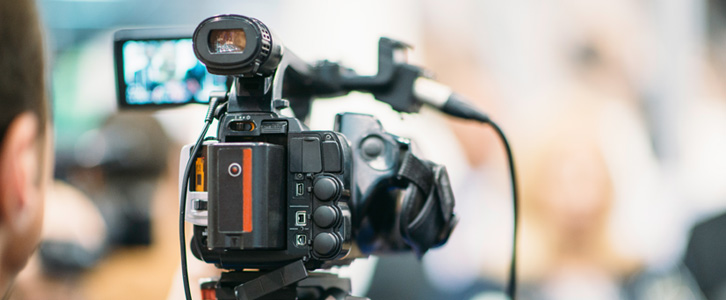 Man filming with a video camera